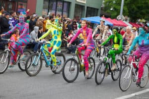 Naked painted cyclists at Fremont Fair