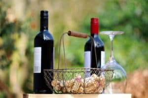 Two bottles of red wine and basket of corks