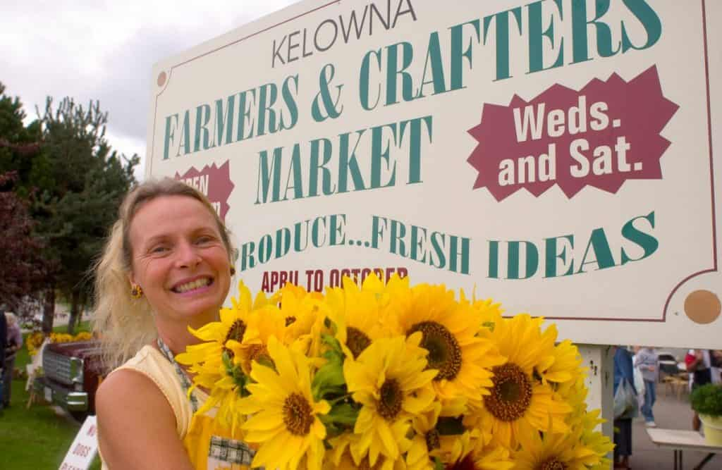 Lady with sunflowers at Kelowna's Farmers Market