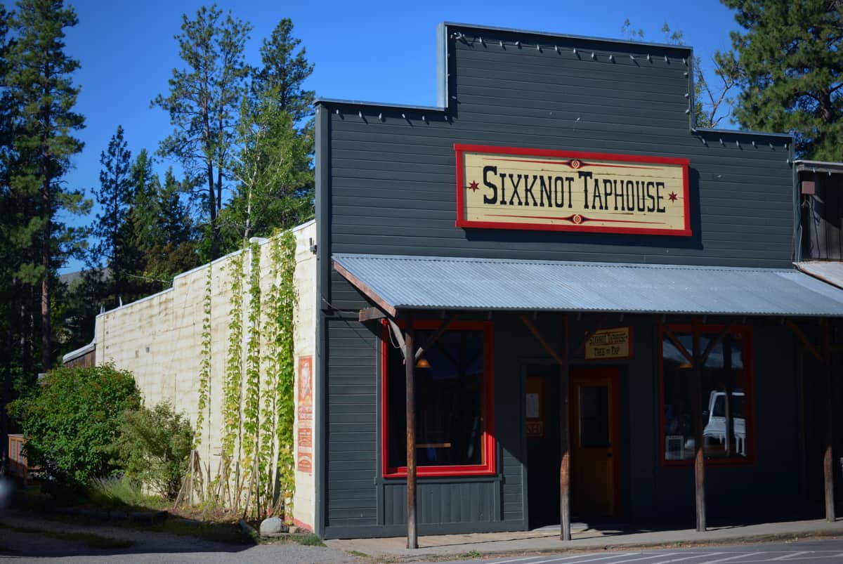 Exterior of the old Western town-looking Sixknot Taphouse in Winthrop WA