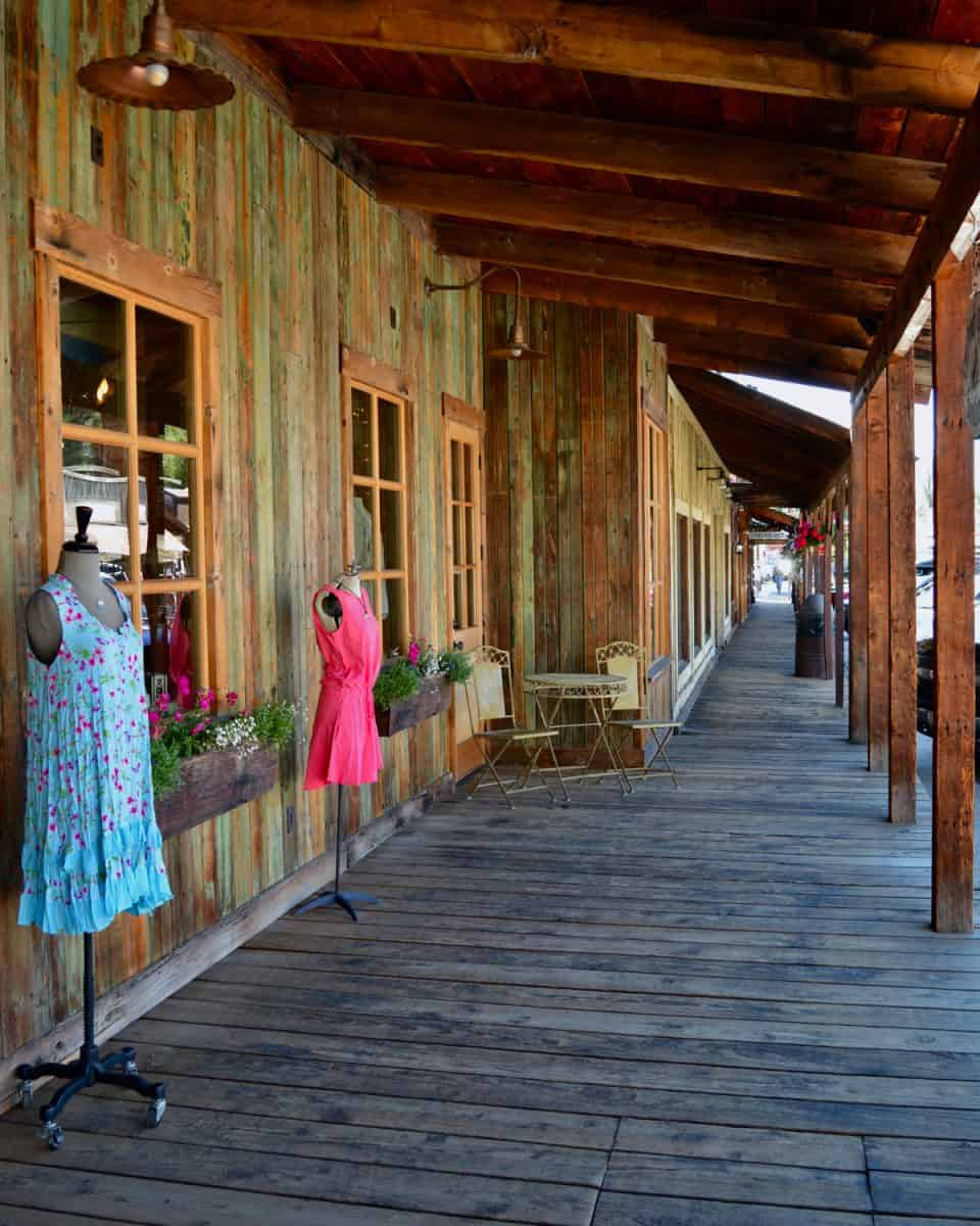 Old-looking wooden boardwalk with shops in the town of Winthrop, WA