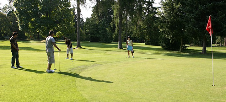 People on a golf course in Stanley Park Vancouver