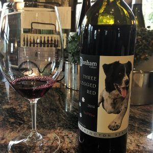 Wine bottle with black and white dog on the label