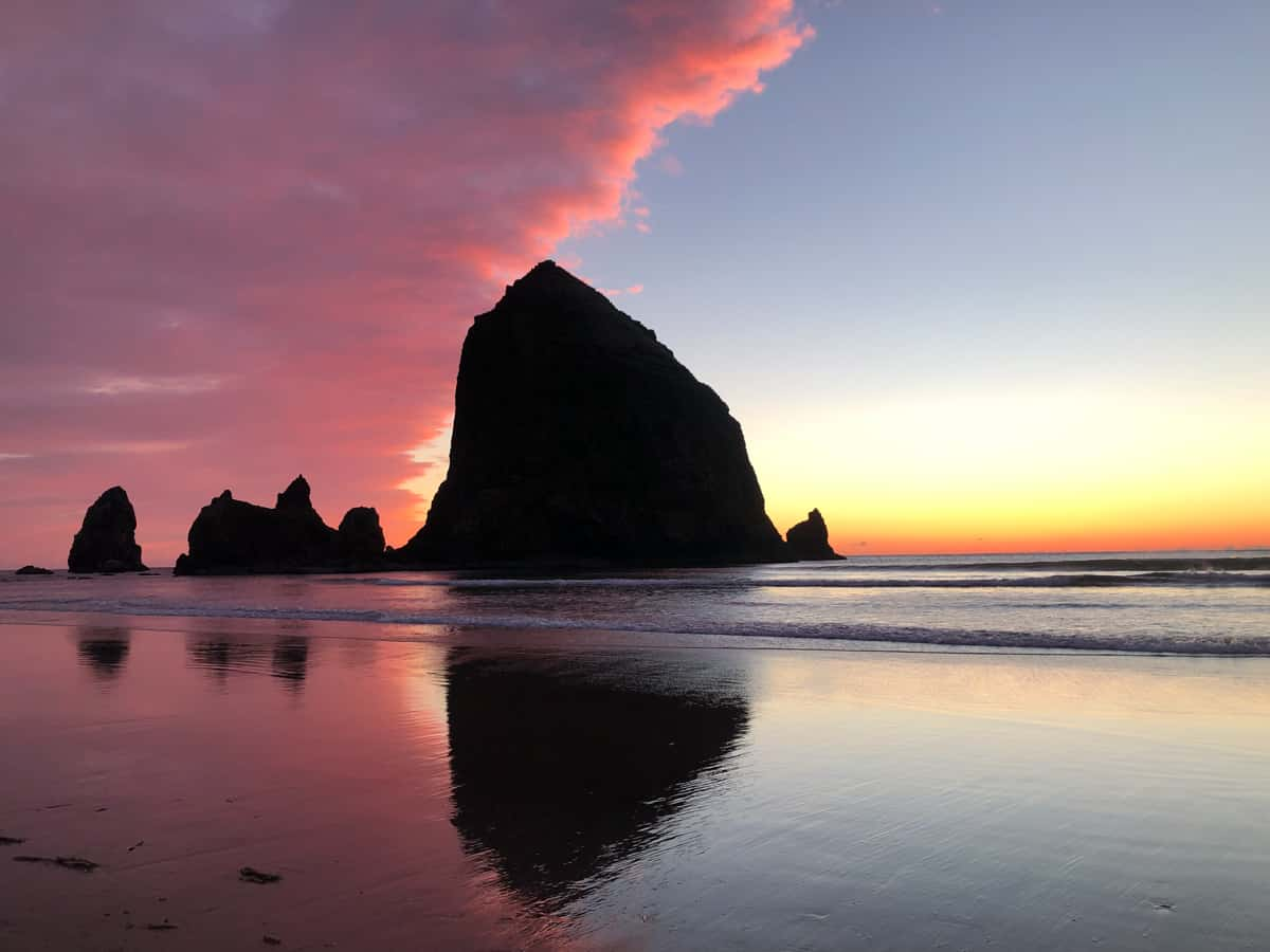 Iconic Haystack Rock on Cannon Beach Oregon with the sunset in the background